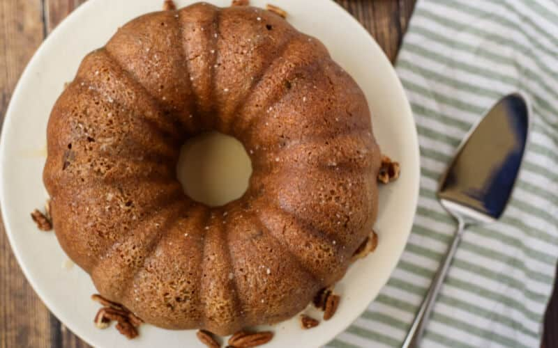 brown sugar pound cake on wooden table with striped napkin