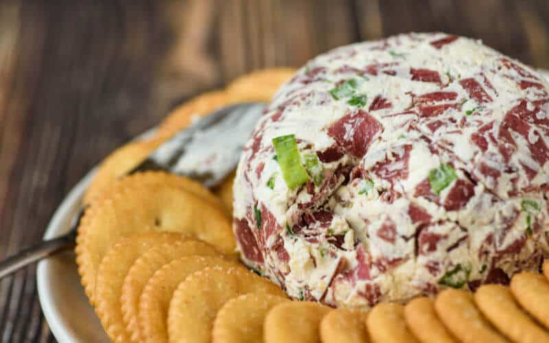 dried beef cheese ball with ritz crackers on table