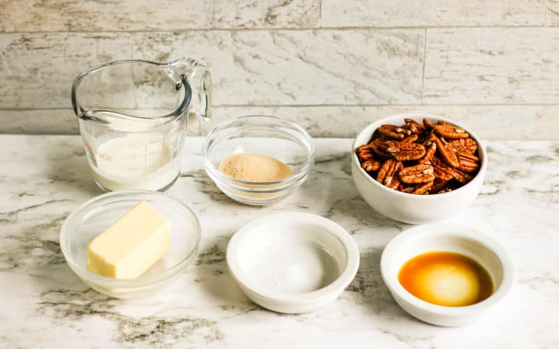 all the ingredients for pecan praline on a table waiting to cook