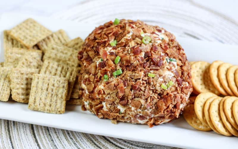 triscuit crackers and other crackers on plate with bacon cheese ball