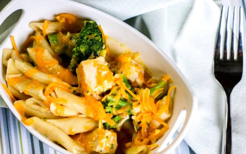 chicken and broccoli pasta from the instant pot on the table with a white napkin