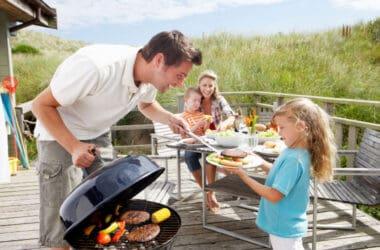 family enjoying their beach dinners on vacation