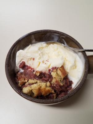 grape hull cake with ice cream in ramekin