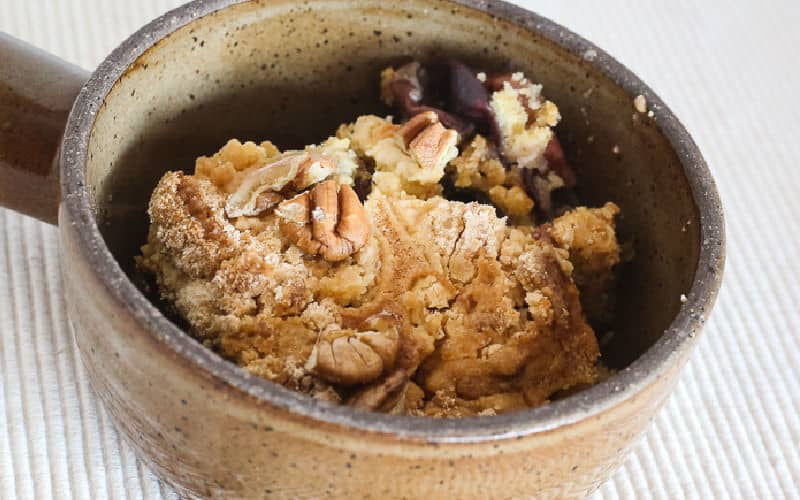 grape hull cake with pecans in ramekin