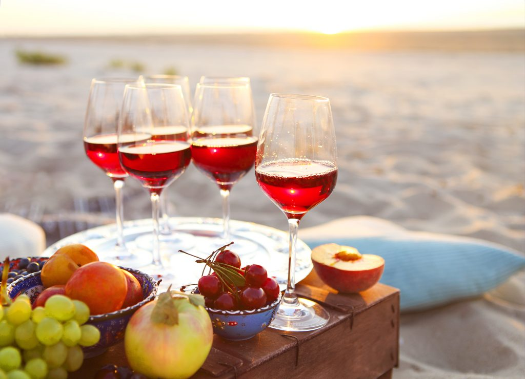 wine and fruit on the beach