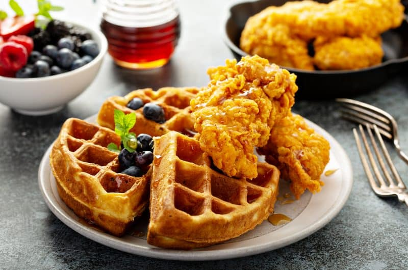 fried chicken and waffles with blueberries