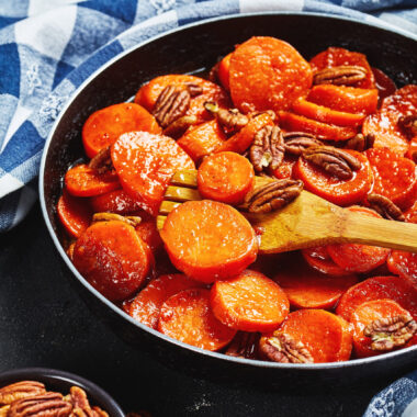 Candied sweet potatoes in a frying pan